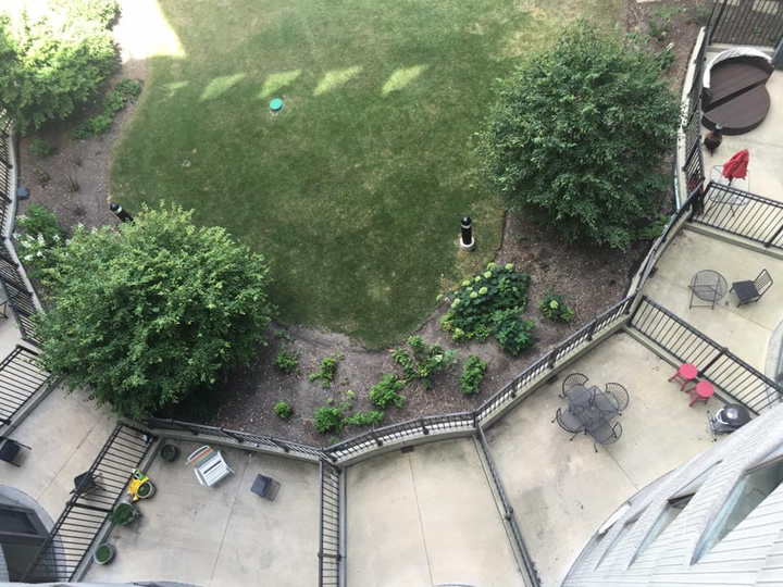 View down to patios on the 5th floor