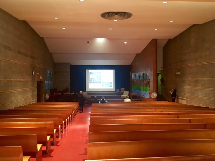 The auditorium has good acoustics, with original Saarinen chairs and desks on the stage. The original bentwood benches are child-sized, with smaller scale benches towards the front and larger ones in the back.
