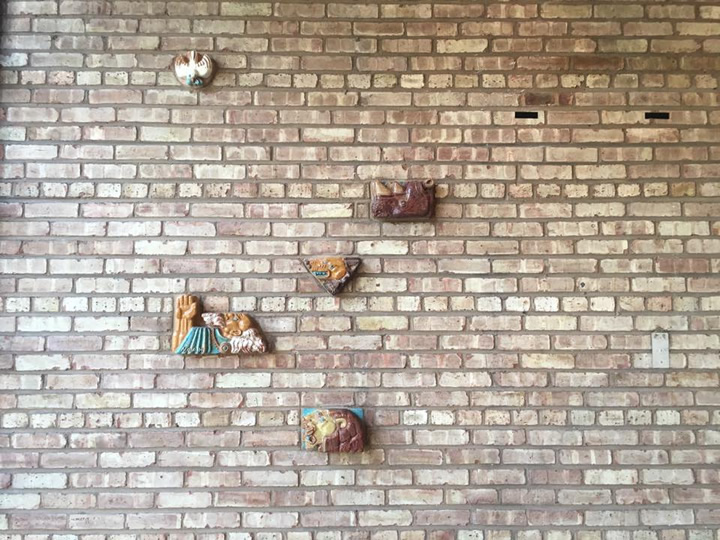 Original ceramics by Lily Swann Saarinen adorn the walls inside and out