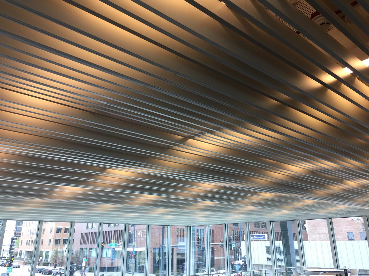 Ceiling system hides lighting