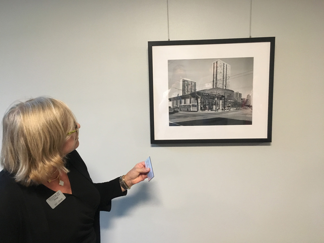 Amy shows some photography in the bank's lower level