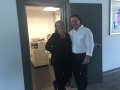 Amy and Joe pose in front of a former vault, now a copier room