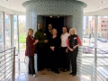 CBB board members pose with bank president Amy Lemar and Lee Bey in the round elevator