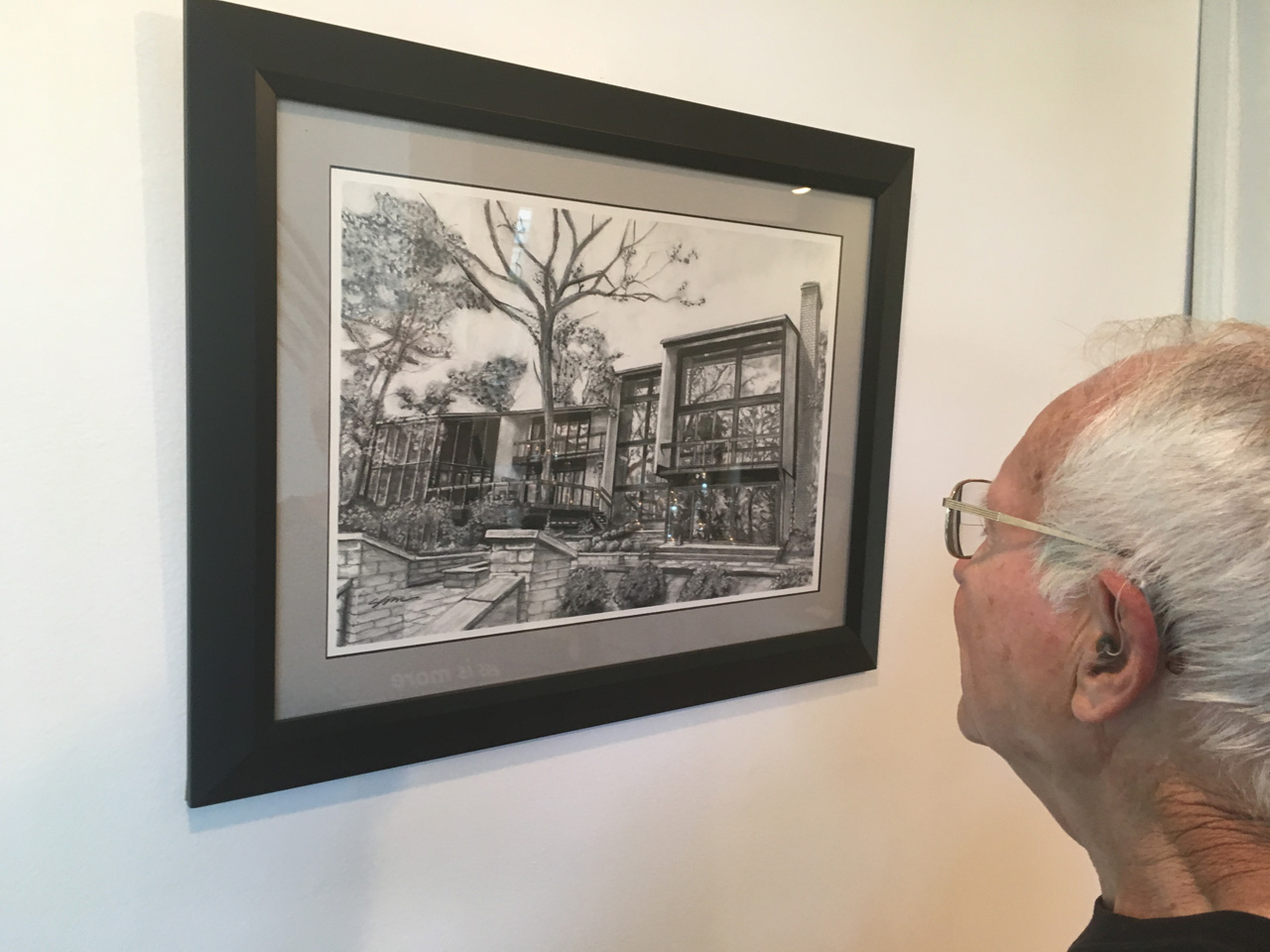Don Wrobleski looks at a sketch of the house