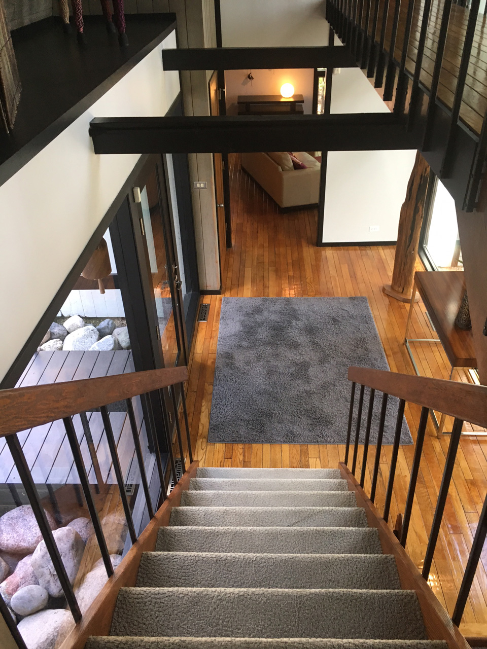 The stairs lead to from the foyer to the master suite bridge and bedroom level